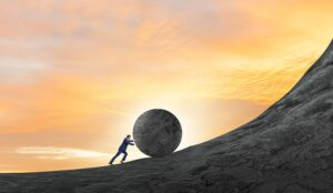 A picture of someone rolling a boulder up the hill