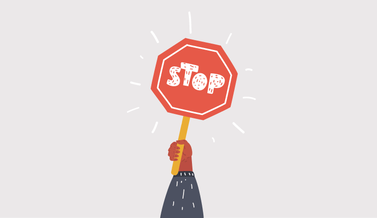 A picture of a stop sign being held-up