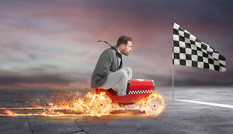 A photo of a business person racing on a cart