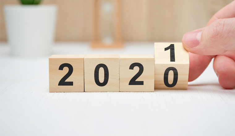 A picture of wooden cubes with numbers 2020 and 2021