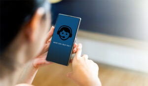 A picture of a chat bot on a mobile phone held by a customer