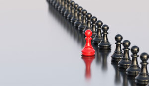 A picture of a chess piece leading the line