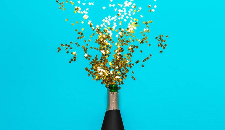 A photo of a champagne bottle with gold stars