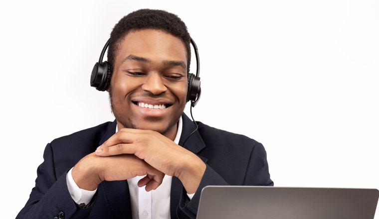 A picture of a happy agent speaking with a headset