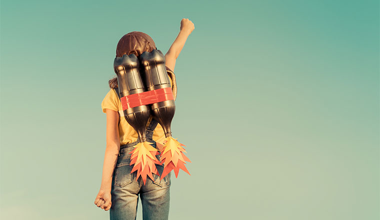 A photo of a kid playing with a jetpack