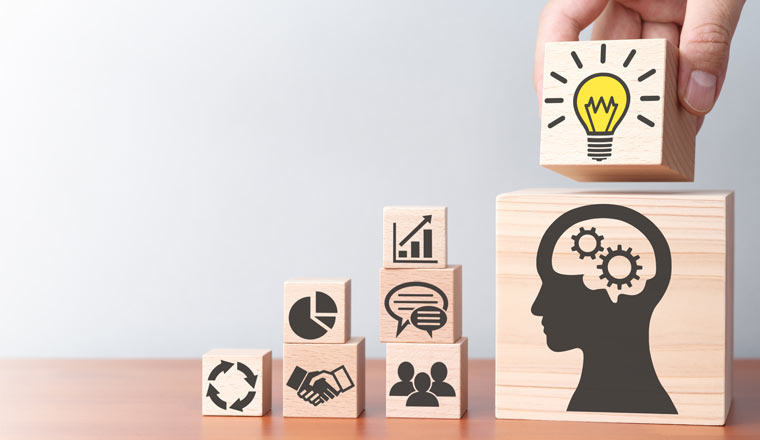 A picture of wooden blocks with business icons