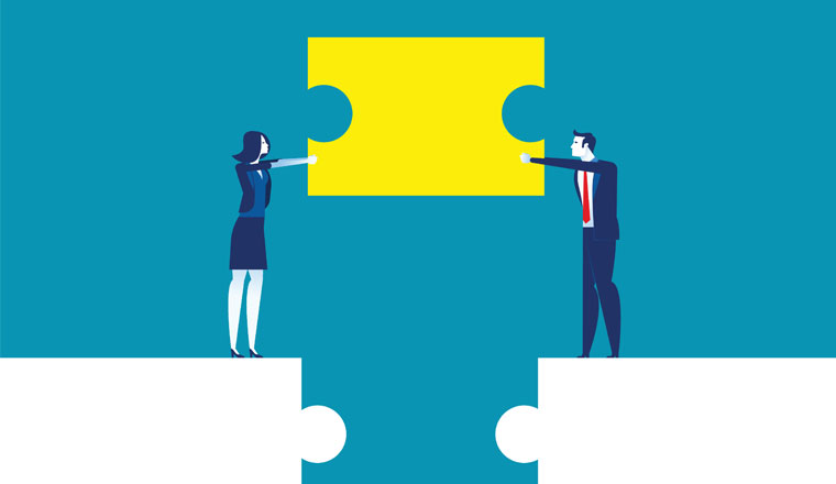 A picture of business partnership connected by a puzzle piece
