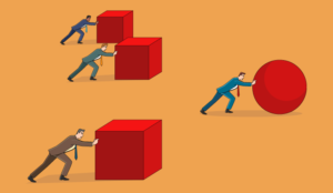 A picture of people pushing cubes and balls