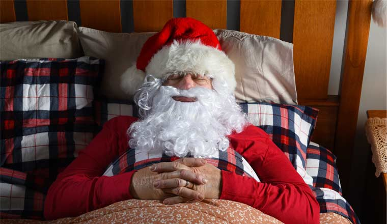 A picture of Santa asleep in bed