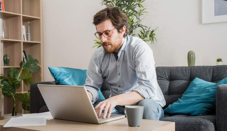 A picture of an agent working at home with laptop
