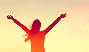 A picture of someone raising their arms in joy
