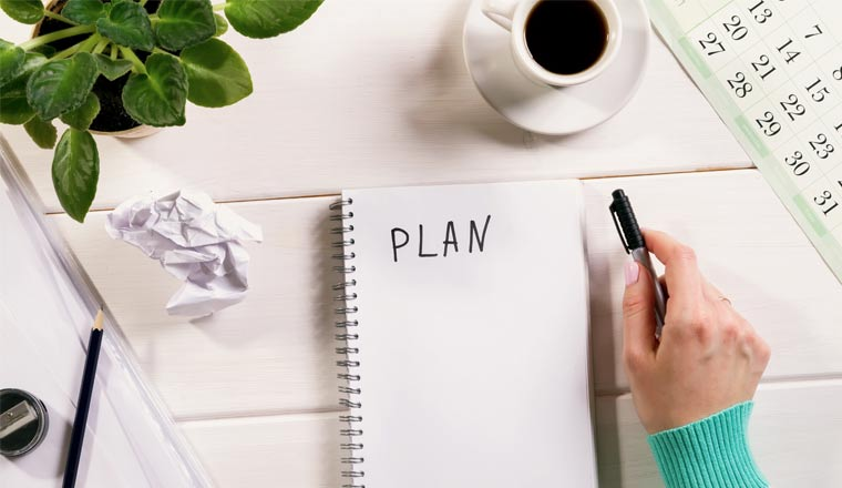 A picture of a blank notebook and the word plan