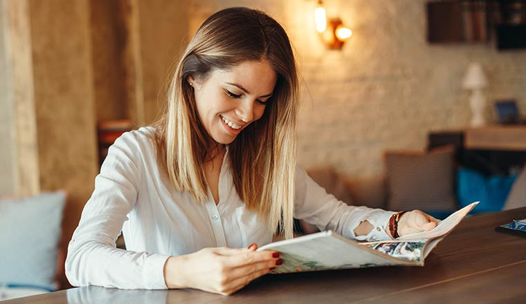 A photo of someone reading a magazine