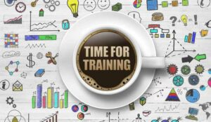 A picture of sketched business icons and a coffee cup with the words - time for training