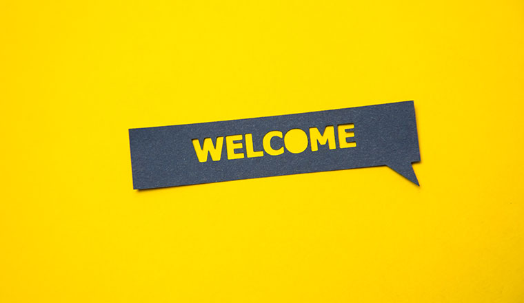 "A photo of a ""welcome"" speech bubble"