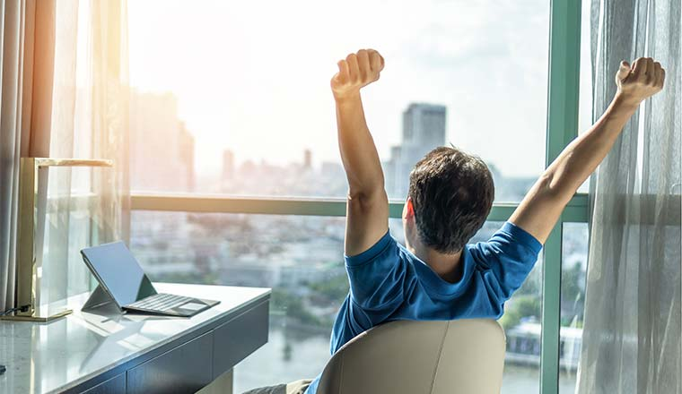 A photo of someone celebrating in an office chair