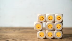 A photo of happy and unhappy dice