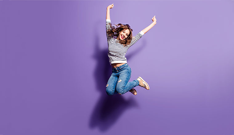A photo of someone jumping for joy