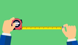 A picture of someone holding measuring tape