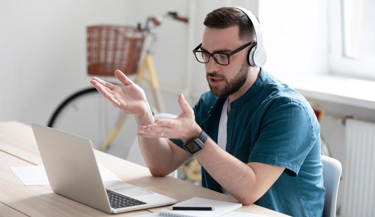 A picture of a remote worker sat at desk