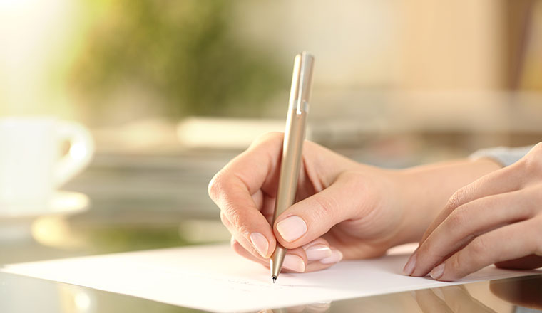 A photo of someone writing a letter
