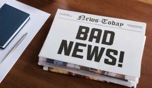 A photo of a bad news headline
