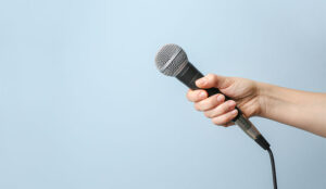 A photo of someone handing out a microphone