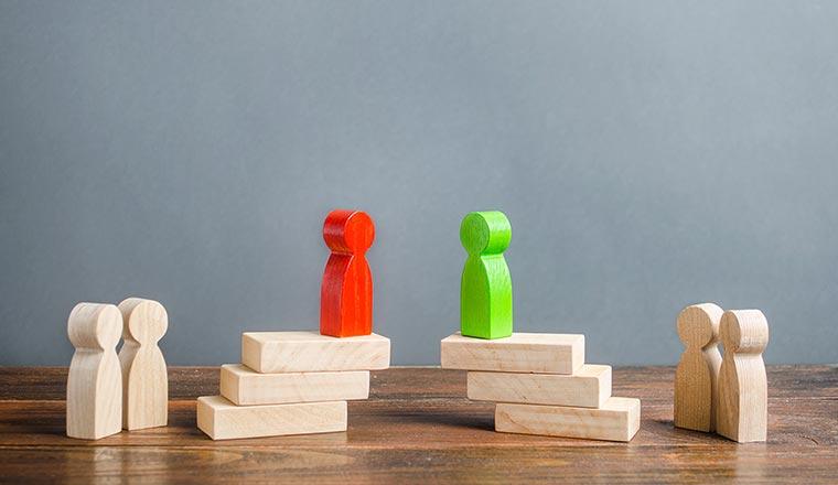 A photo of block figures negotiating