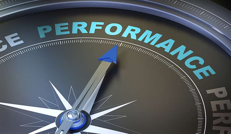 """A picture of a compass pointing towards the word """"performance"""""""