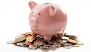 A picture of a piggy bank sat on a pile of coins