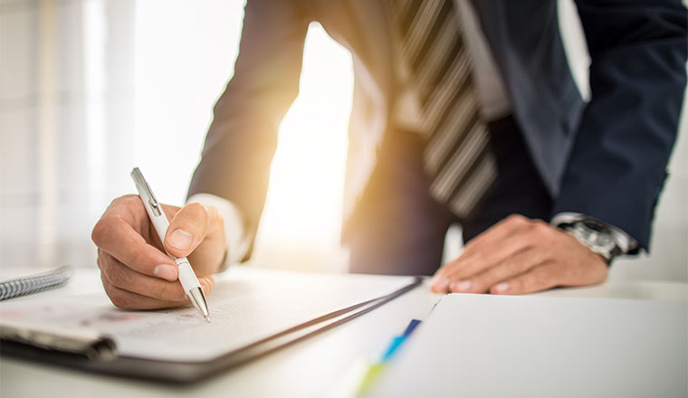 A photo of someone signing a contract