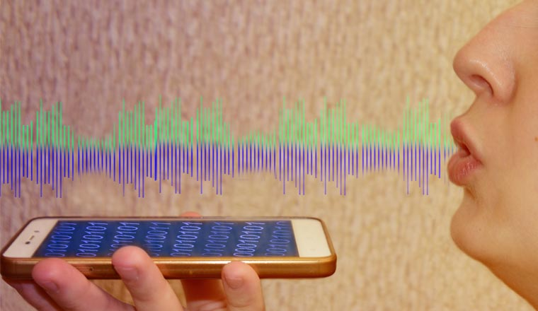 A picture of a lady speaking into a mobile phone with sound waves