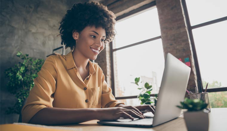 A picture of a woman working at home on laptop