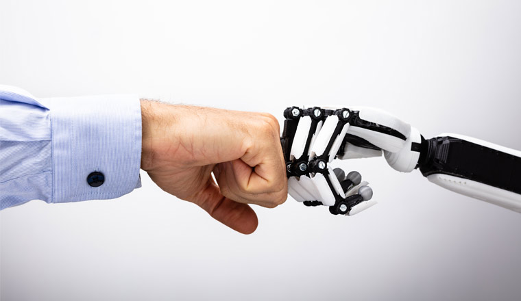 A picture of a robot hand and human hand