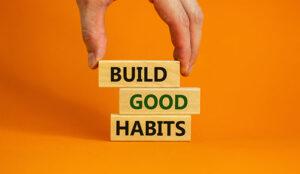 "A photo of blocks that say: ""Build good habits"""