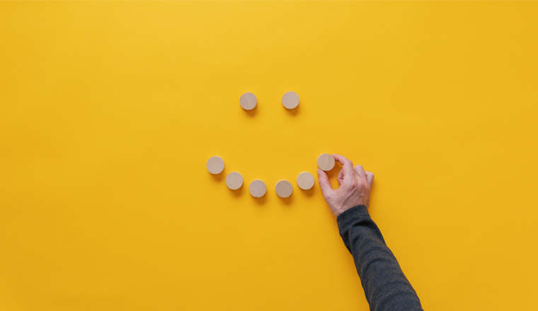 A picture of a smiley face made out of wooden blocks
