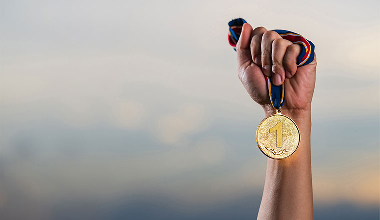 A photo of a gold medal winner