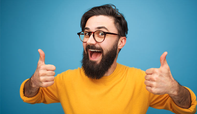 A picture of a happy customer holding his thumbs up
