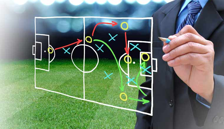 A picture of a coach planning for a sports manoeuvre