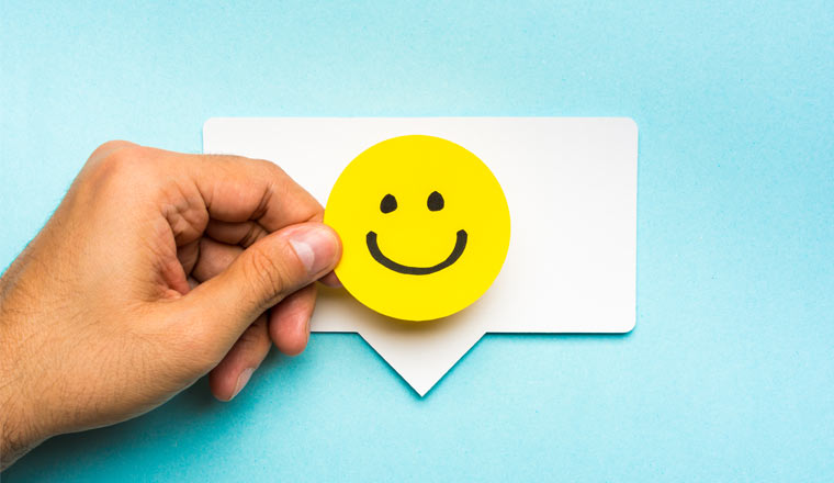 A picture of a happy face smiling on speech bubble
