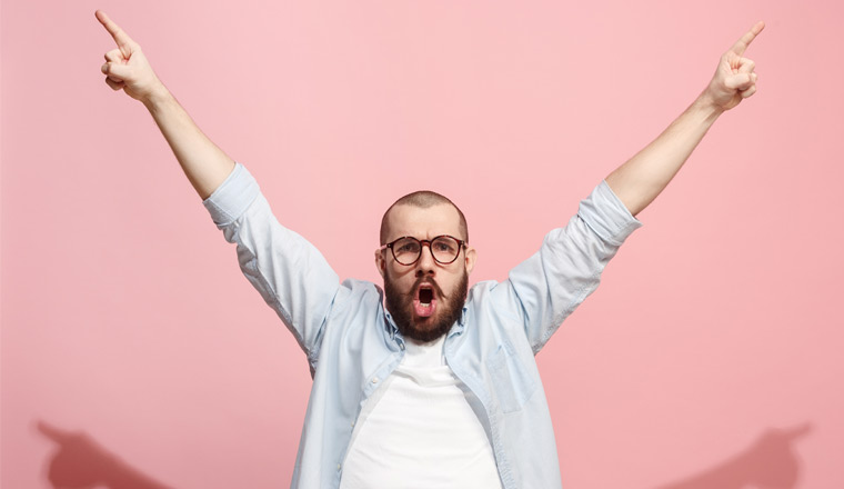 A picture of a happy man holding his arms in the air