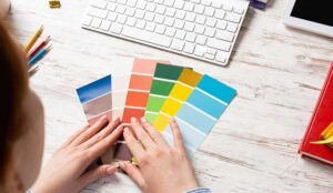 A picture of someone looking at colour swatches on a desk
