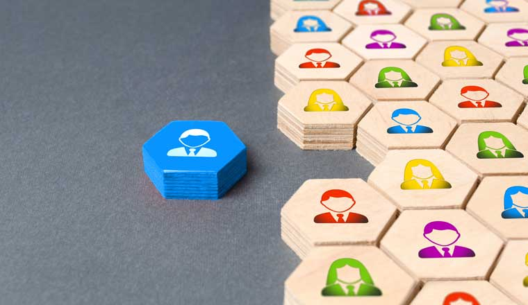 A picture of a blue hexagon with a picture of a person next to a group of wooden hexagons
