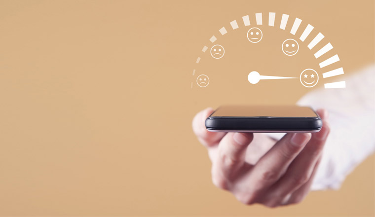 A hand holding a phone with a satisfaction meter above