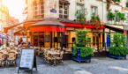 Cozy street with tables of cafe in Paris