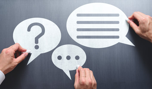 A picture showing three hands holding speech bubbles with communication icons in them