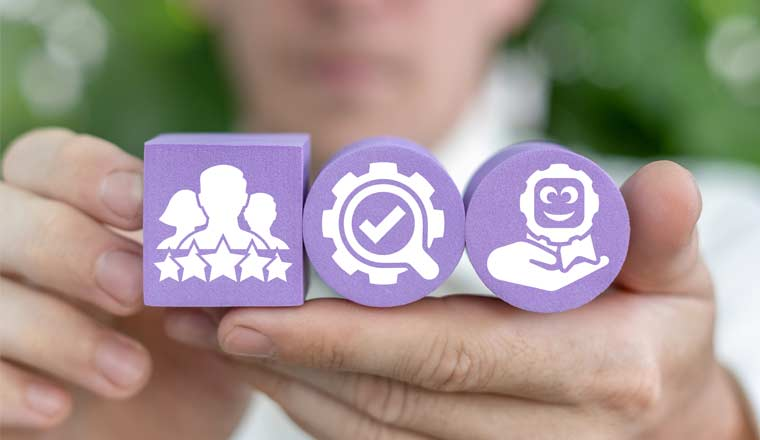 A picture of a person holding one purple cube with a rating icon, and two purple cylinders with other CX icons