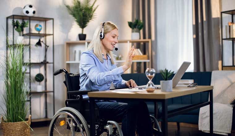 Person on a laptop wearing a headset
