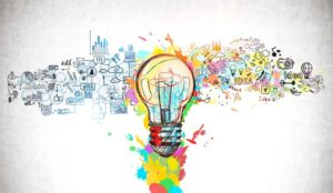An illustrated drawing of a lightbulb and icons for creative thinking