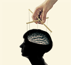 An image of a head with puppet strings attached to the brain